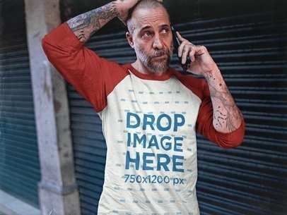 White Middle-Aged Man Wearing a Raglan Tee Mockup While Making a Phone Call on the Street a12607