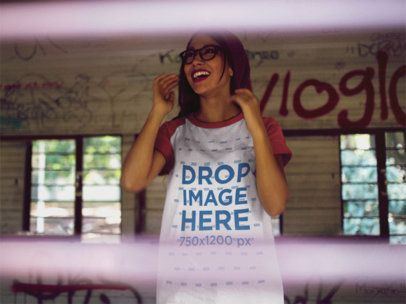 Raglan Tee Mockup of a Young Trendy Girl with a Beanie Laughing Inside an Abandoned Building a12482