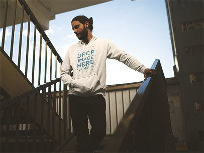 Hipster Guy Wearing a Pullover Hoodie Mockup Walking Down the Stairs a12598
