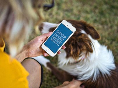 iPhone Mockup in Portrait Position of a Woman Petting Her Dog in a Park 12806
