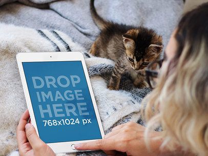 Young Woman Lying in Bed with her Kitten and Using a White iPad Mini Mockup 12791standard