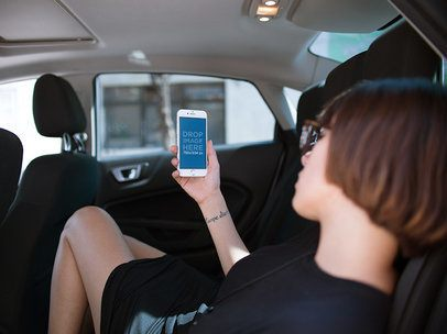 iPhone Mockup in Portrait Position of a Woman Resting in a Car 12490