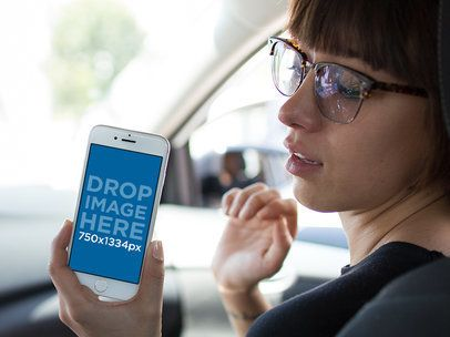 Mockup of a Woman Showing an iPhone 6 in Portrait Position in the Passenger's Seat 12941