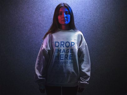 Crewneck Mockup Featuring a Girl with Long Hair Standing in Blue and Red Lights a12724