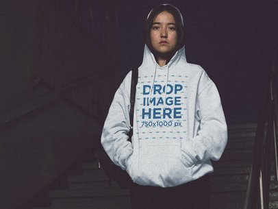 Pullover Hoodie Mockup Featuring a Young Asian Girl Walking Down the Stairs a12695