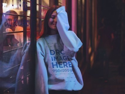 Pretty Girl with Long Hair Wearing a Crewneck Mockup and Covering Half her Face a12692