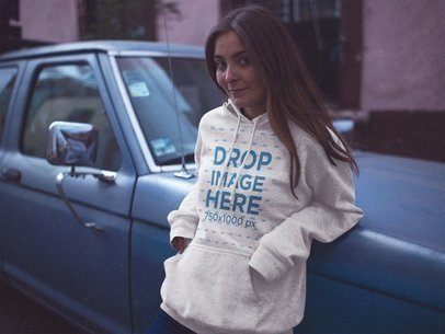 Pullover Hoodie Mockup of a Pretty Young Woman Leaning on a Car at Dusk a12720