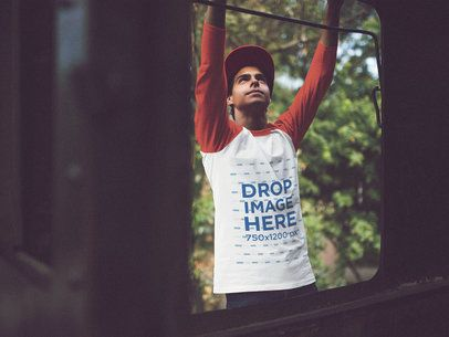 Raglan Tee Mockup of a Young Man Hanging From a Train Wagon a12514