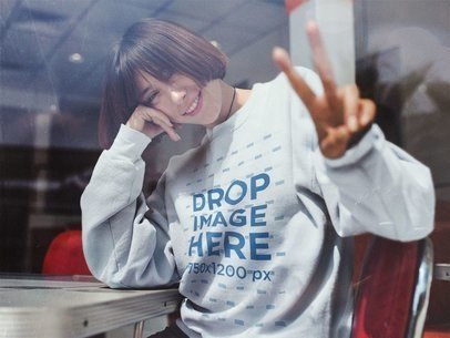 Crewneck Mockup of a Smiling Young Asian Girl Doing a Peace Sign Pose a12667