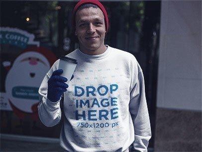 Guy with a Crewneck Sweatshirt Picking Up a Coffee Mockup a13202