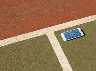 Mockup Of White iPhone 6 Lying On A Tennis Court a14096