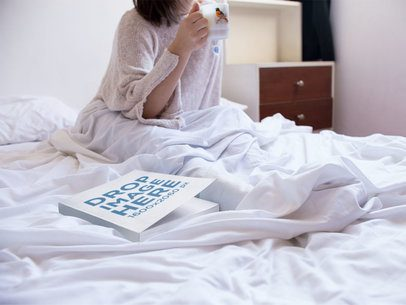 Mockup of a Book Lying on a Womans Bed While Shes Drinking a Coffee in the Morning a14301