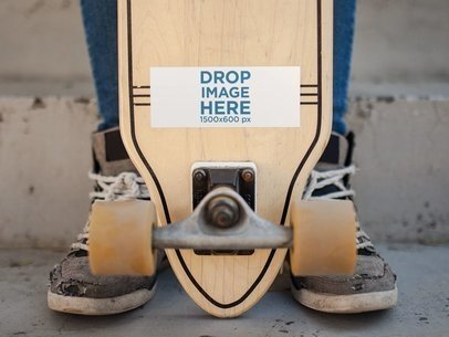 Horizontal Sticker on a Longboard Held by a Man Mockup a14337