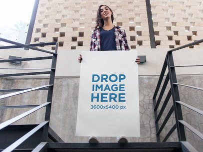 Pretty Girl Holding a Big Poster While in Stairways in the City Mockup a14467