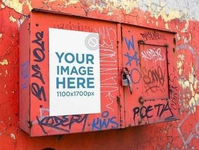 Mockup of a Poster Placed on a Graffiti Metal Box a14409
