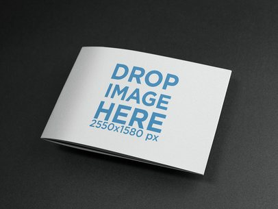 Closed Booklet on a Black Surface Mockup a14585