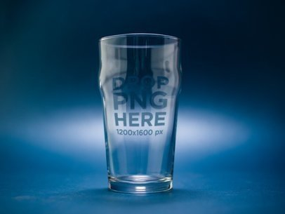 Mockup of an Empty Nonic Pint Beer Glass Against a Dark Blue Background a14658