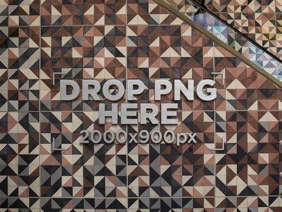 Template of a 3D Metal Logo on a Mosaic Wall Near an Escalator a14537