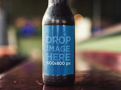 Dark Beer Bottle Label Template While on a Counter Bar a14785