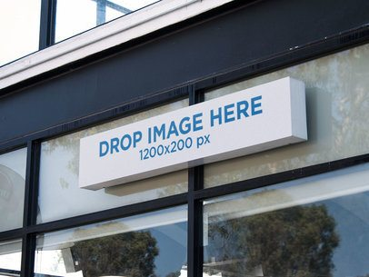 Long Horizontal Sign Mockup Outside a Front Window of a Store a14978