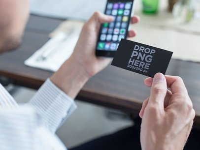 Business Man Using a Foil Business Card Mockup to Contact a Person with his Phone a15032