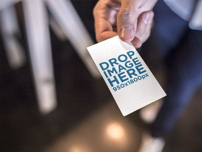 Vertical Business Card Mockup Being Held by a Man a15031