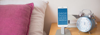 iPhone Mockup of an iPhone 6 Standing on a Nightstand a3843