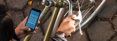 iPhone 6 Mockup of a Young Man Using an iPhone While Riding a Bike a3560wide