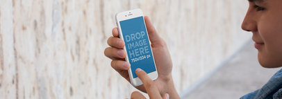 iPhone Mockup Featuring a Guy Holding an iPhone 6 a5708