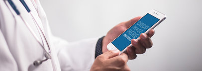 iPhone 6 Plus Mockup Featuring a Doctor Holding an iPhone in Portrait Position a12399