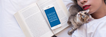 iPhone 6 Mockup of a Girl Lying in Bed with her Cat a12799wide